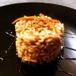 Orange risotto, cocoa, honey, balsamic vinegar and amaretti