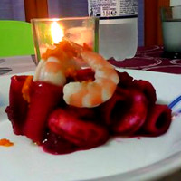 Paccheri pasta with prawns blanched beet and orange peel